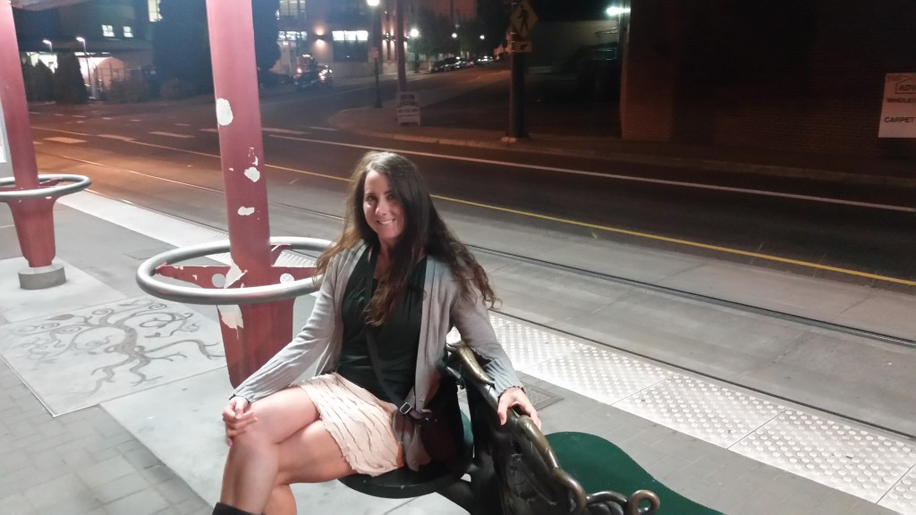 Victoria waiting on the train to dinner.