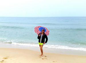 Victoria posing in the rain on the beach in Mui Ne