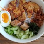 A cold refreshing noodle dish with chicken and soft boiled egg.