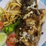 Whole fried snapper. Served with rice on the side of course.