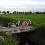 Riding bikes along the rice paddy fields