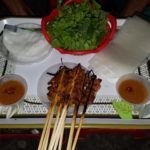 Grilled chicken skewers.  50 cents each and comes with spring roll accessories. Make yourself.  So fun to assemble and eat!